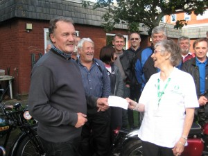 Alex presenting Cheque for £250 to Macmillan Rep 18th Sept' 2011
